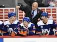 Islanders head coach Barry Trotz talks to his