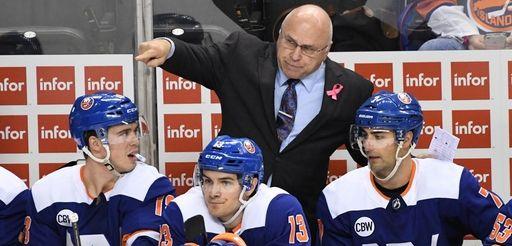 Islanders head coach Barry Trotz talks to his