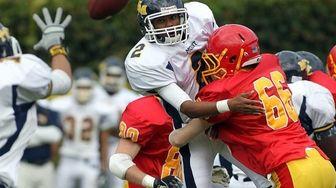 Mount St. Michael quarterback Jaylen Amaker (2) pitches
