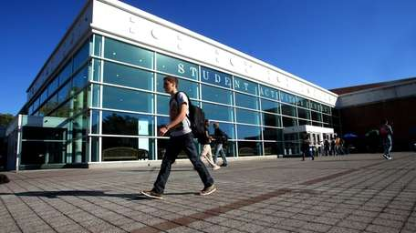 Students walk past the student activity center at