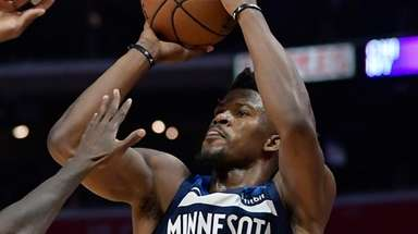 Jimmy Butler, then with the Timberwolves, shoots as