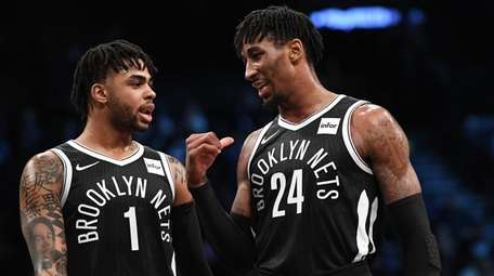 Nets forward Rondae Hollis-Jefferson, right, and guard D'Angelo