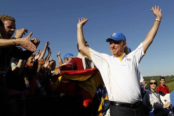 Europe's Miguel Angel Jimenez is congratulated by the