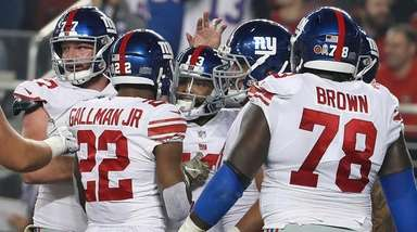 Odell Beckham Jr., center, is congratulated after a