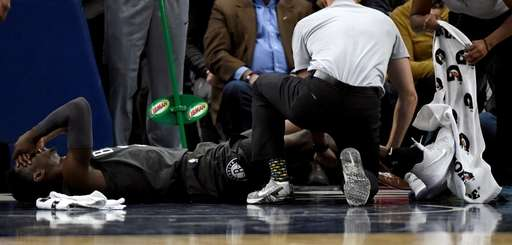 Nets guard Caris LeVert is tended to after