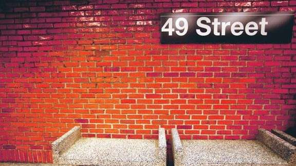 Red brick and cantilevered seating are part of