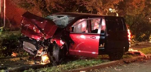 The Dodge Caravan after the crash on Asbury