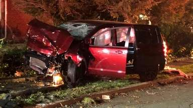 The Dodge Caravan after the crash on Asbury