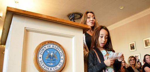 Sophia Cortese, 9, of Lindenhurst, with her mom,