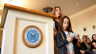 Sophia Cortese, 9, of Lindenhurst, with her mom,