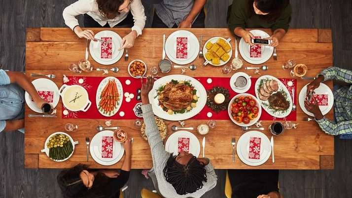 A group gathered around the Thanksgiving table.