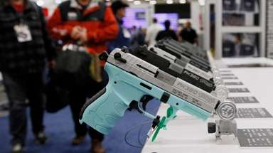 Handguns are on display at the NRA convention