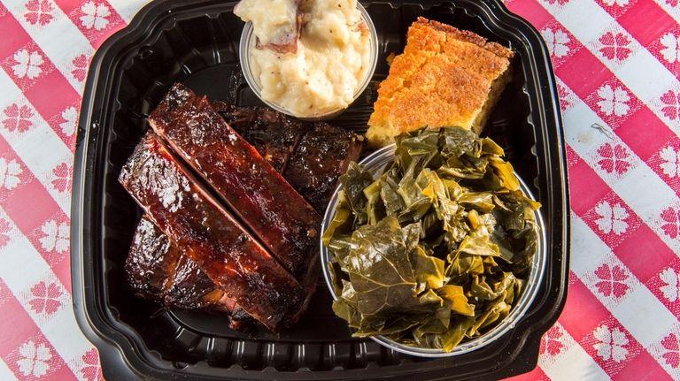 A rib platter with collard greens, garlic mashed