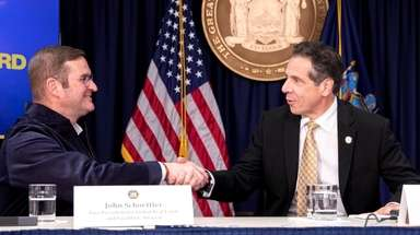 Gov. Andrew M. Cuomo greets John Schoettler, vice