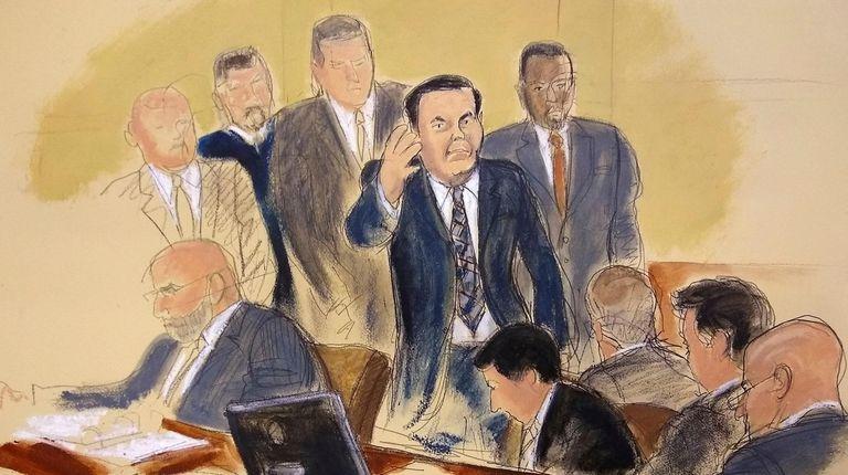 """Joaquin """"El Chapo"""" Guzman, surrounded by US Marshals,"""