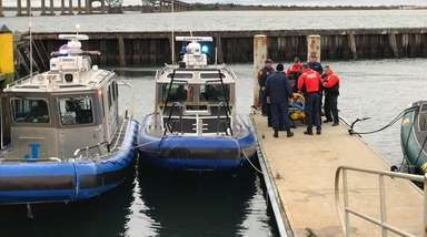 Rescued boater Greg Antolini is transferred from a