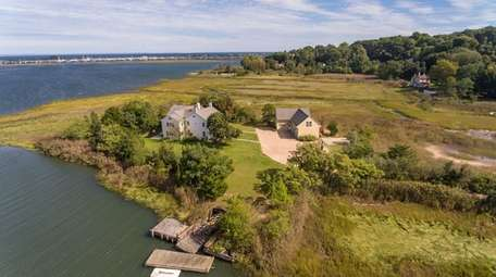 The 1.5-acre property offers views of Mount Sinai