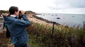 Visitors gaze at the shoreline on Plum Island.