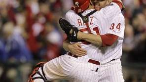 Philadelphia Phillies starting pitcher Roy Halladay celebrates with