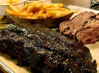 Baby-back ribs, left, and brisket are among the