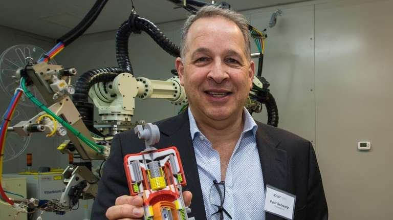 Paul Schwartz, CEO of ThermoLift, holds a protype