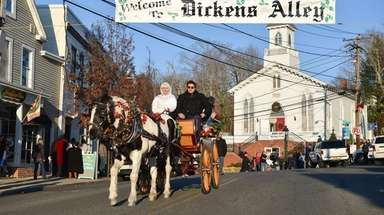 Visitors to the Charles Dickens Festival take a