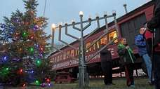 The menorah is lit during a ceremony at