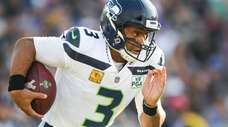 Russell Wilson #3 of the Seattle Seahawks carries