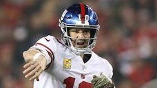 Giants quarterback Eli Manning attempts a pass against