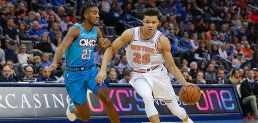 Knicks forward Kevin Knox (20) drives to the