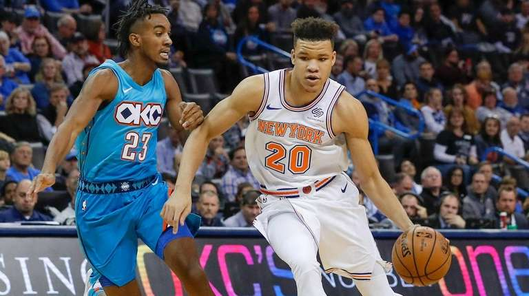 Knicks forward Kevin Knox (20) drives to the