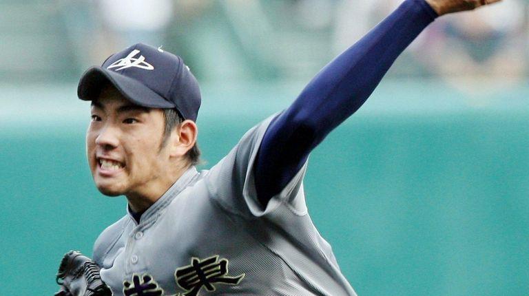 Yusei Kikuchi of Hanamaki Higashi high school pitches