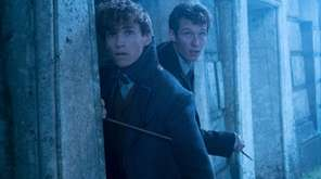 Eddie Redmayne, left, who plays Newt Scamander, and