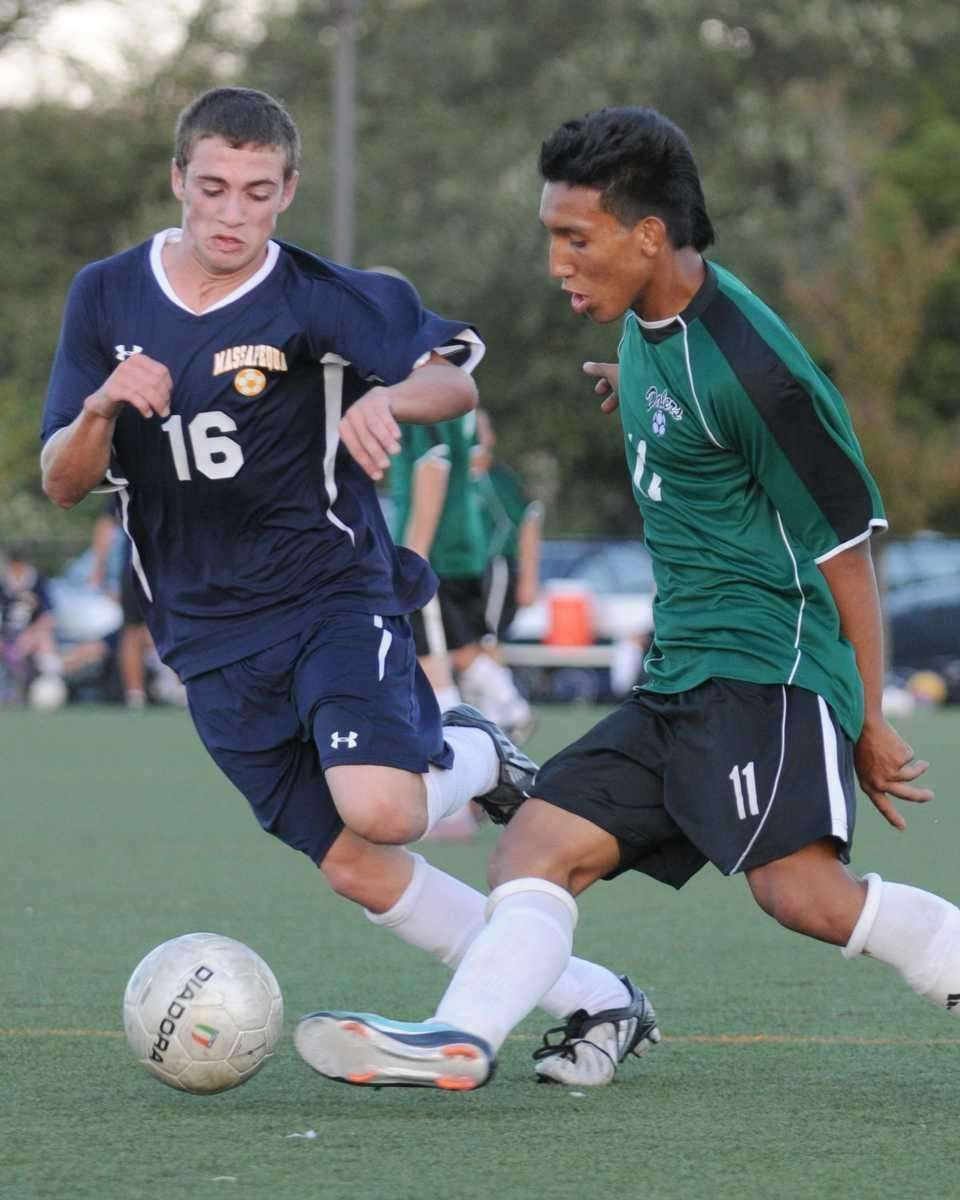 Farmingdale High School #11 Victor Montano, right, gets