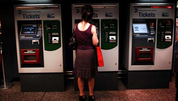 Commuters buy LIRR tickets at Penn Station. (July