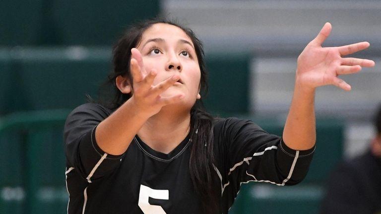 Long Beach's Kathleen Verastegui serves against Plainview-Old Bethpage