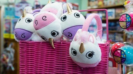 A basket of unicorn ear muffs, popular gift