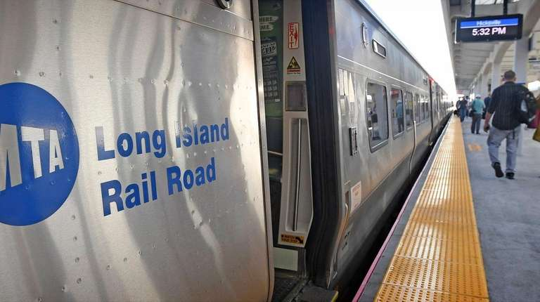 Commuters at the Hicksville LIRR Train Station make