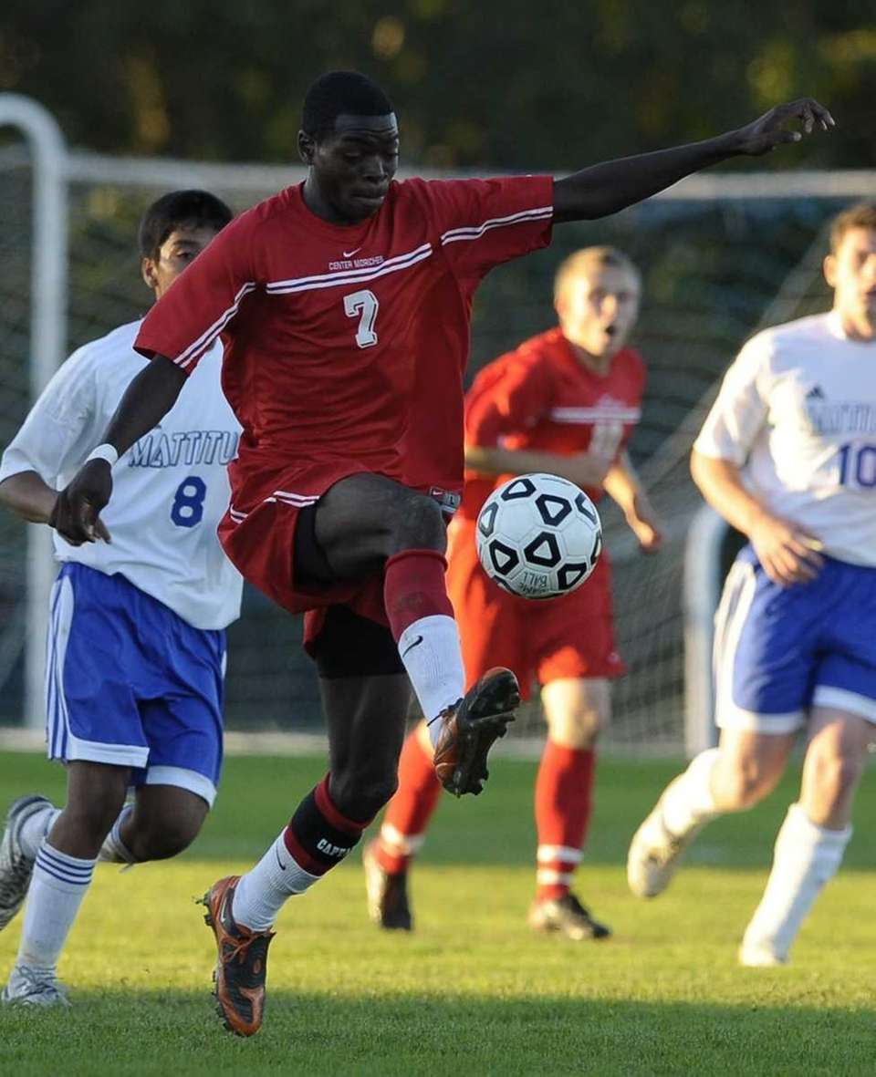 Center Moriches' Harvey Houpe moves the ball down