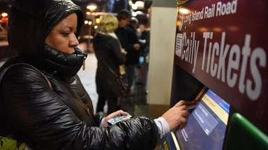 Commuter Margie Major of Elmont purchases tickets at