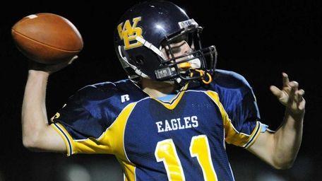 West Babylon High School quarterback #11 Alex Hennessy