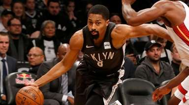 The Nets' Spencer Dinwiddie drives to the hoop