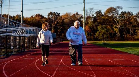 Joan Verardo and her husband, Louis, walk around