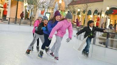 Skaters enjoy the outdoor ice skating rink at