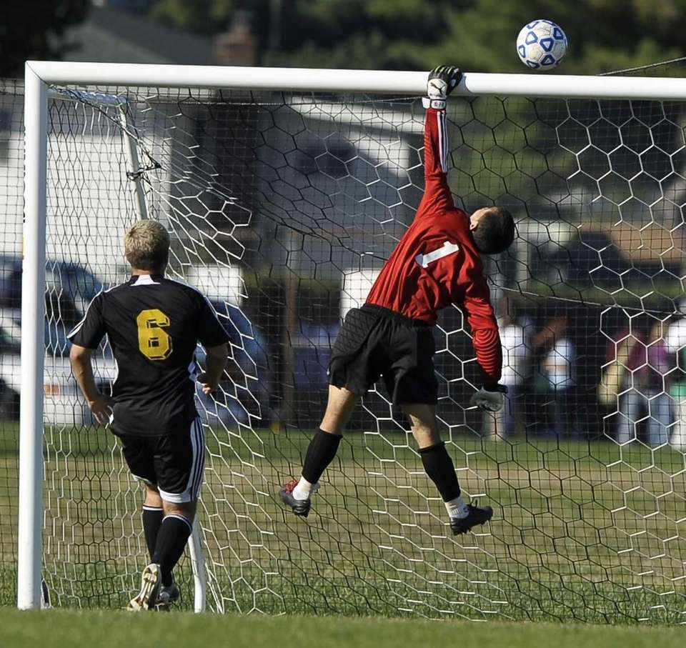 Brentwood's Herson Guzman saves a shot on goal