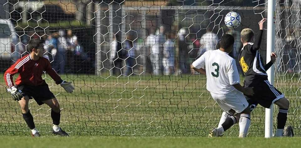 Commack's Harrison Sussman heads the ball into the