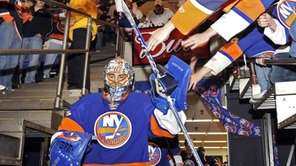 New York Islanders' goalie Rick DiPietro is greeted