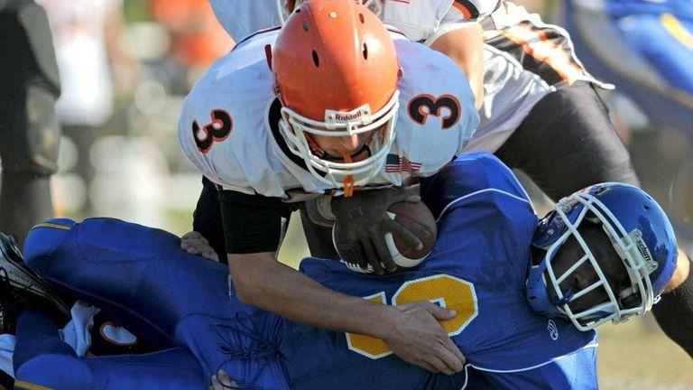 Roosevelt High School quarterback #9 Erin Parker gets