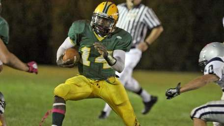 Lynbrook's QB Paul Magloire looks for room to