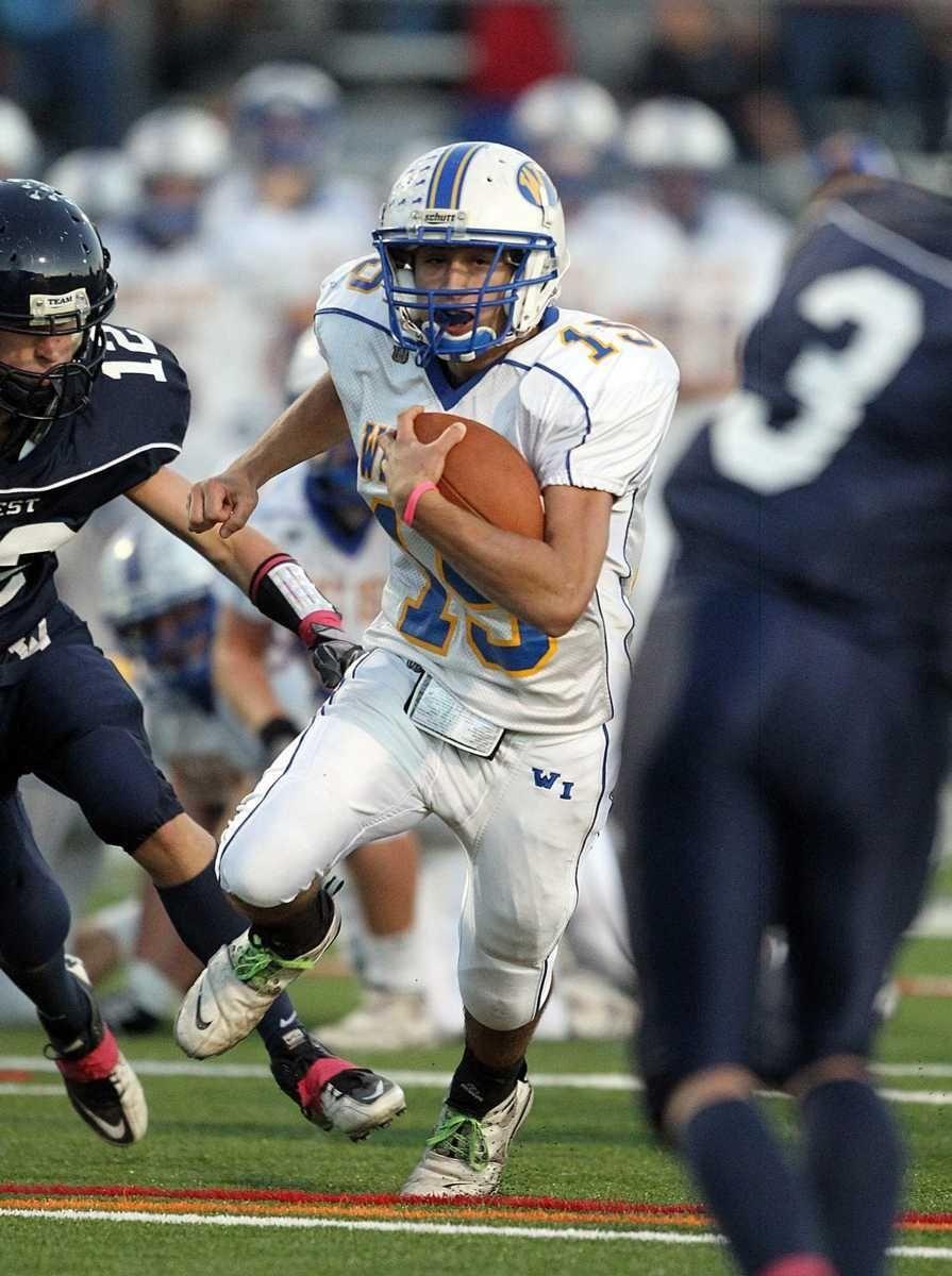 West Islip quarterback #15 breaks into the secondary